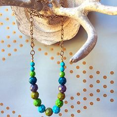 New! Festive strand necklace made with hand painted glass beads