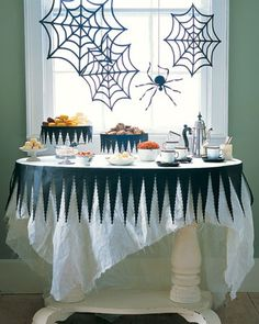 25 Tips and Inspiration for Your Halloween Candy Table  I like the black around the cake plates , you could use plain cake plates and dress the up.