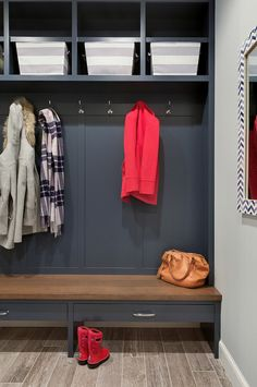 Mudroom cabinets are enameled in Hale Navy by Benjamin Moore HC-154. The walls are BM Silver Chain.