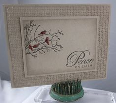 """By Carol Payne. Four layers of Crumb Cake cardstock. Main image panel sponged at edges, stamp from """"Serene Silhouettes"""" by Stampin' Up. One panel dry embossed in Stampin' Up """"Square Lattice"""" embossing folder then sponged. Birds highlighted with Cherry Cobbler Sazzling Details. More info on her website."""