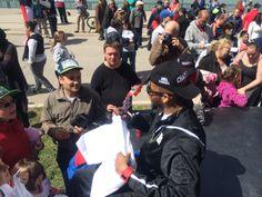 George Goode signs autographs for fans after the championship parade.