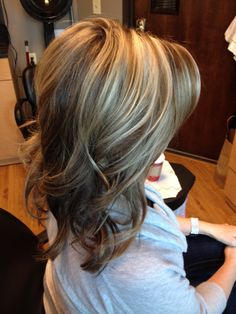 Light brown hair and white blond highlights with curls