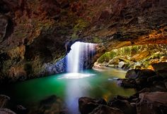 Waterfall plunges into a natural cave in the Springbrook National Park - Queensland, Australia