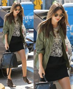 "Miranda Kerr. Her ensemble consisted of a black skirt, a black-and-white printed T, a green utility jacket, cat-eye sunnies, and a structured leather bag. She used her go-to booties, a pair of ""Dicker"" booties from Isabel Marant, to finish the look and left them unzipped for a more relaxed feel."