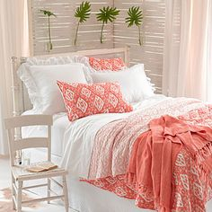 Annie Selke deems coral her color inspiration of the year. Comfy bedding in a happy pattern instantly brightens a beach house bedroom. | coastalliving.com