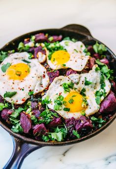 Purple Sweet Potato and Kale Hash with Fried Eggs via A House in the Hills