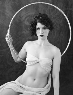 The Vivacious Miss Audacious, aka Audria Larsen of Audacious Hoops, poses for a hoop photo inspired by our piece on Alfred Cheney Johnston and the Ziegfeld Hula Hoop Nudes Mystery. She lives in Grand Rapids, Michigan, USA. Photo by Jean Orians. A Hooping.org Photo of the Day.