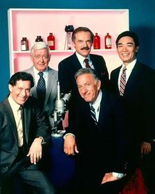 "Sgt. Brill (Joseph Roman) Lt. Monahan (Garry Walberg) Dr. Robert Asten (John S. Ragin) Sam Fujiyama (Robert Ito) Dr. Quincy (Jack Klugman) Quincy, M.E. TV was a 60 minute drama series on NBC. Plotlines would begin with a death that would appear to be from natural causes. However, something would cause him to suspect foul play. Then he would changes from M. E. to detective and solve the murder that was  ""unseen"" by all others."