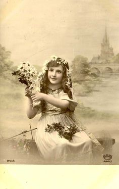 http://www.ebay.com/itm/POSTCARD-VINTAGE-Real-photo-A-GIRL-WITH-FLOWERS-5-/282012873990