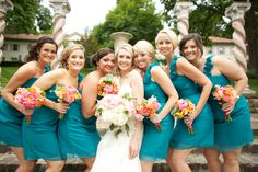Love the teal dresses with warm colored flowers!