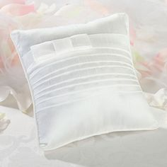 White Pleated Ring Bearer Pillow covered in white satin. The middle of this ring bearer pillow is accented with pleats topped off with a matching satin band. The look is finished with a petite satin bow. Wedding Ring Cushion, Cushion Ring, Ring Bearer Pillows, Ring Pillows, Wedding Toasting Glasses, Lillian Rose, Home Wedding, Wedding Ideas, Trendy Wedding