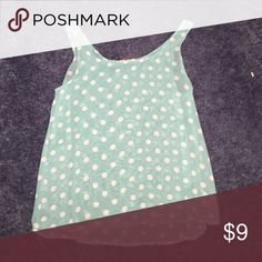 Thin polka dotted tank Light blue polka dot tank top pretty thin so I would wear it with a white tank top underneath Forever 21 Tops Tank Tops