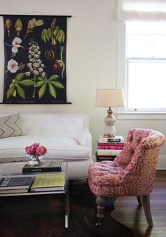 A great cheap and chic trick for those of us decorating on a budget is to use a tall stack of coffee table books in place of a side table. Just don't try and move it around the room! Decor, Stylish Living Room, White Home Decor, Family Living Rooms, Home Decor, Interior Design Chair, Apartment Inspiration, Cozy Interior, First Apartment