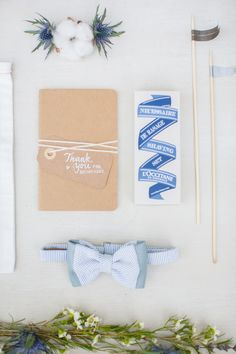 rustic wedding invitations with blue touches // photo by Bubblerock // http://ruffledblog.com/bordeaux-beach-wedding-inspiration