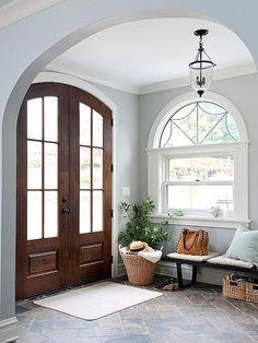 Very pretty ... subtle smoky blue walls, white trim, dark stained door, black/ORB hardware