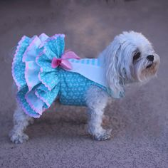 * Dog fashion for small dog, handmade dress * Dog dress features a sailor theme with a cute anchor print on pink background * Dog harness dress features three ruffles and is very full * Summer dog dress is accented with pink rick rack trim and pink satin bow at girth for added color