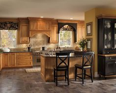 Make Your Kitchen Look Elegant with Schuler Cabinets: Black Countertop In Traditional Kitchen Ideas With Floral Arrangement And Floral Window Treatment Also Recessed Lighting With Schuler Cabinets And Under Bar Top Plus Grey Tile Flooring Also One Handle Kitchen Faucet ~ jangrue.com Furniture Inspiration