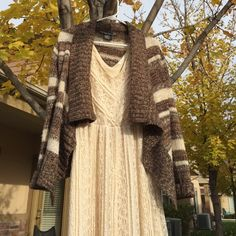 Striped Cardigan Knit sweater cardigan. Various shades of brown and cream. Flowy front. Super comfy. Sweaters Cardigans