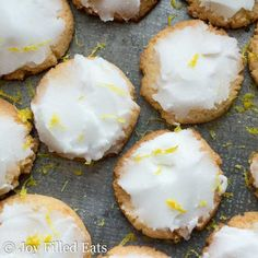 Iced Lemon Cookies. Crisp and buttery lemon scented cookies topped with a sweet and tart icing. These go great with a cup of earl grey tea and a good book.