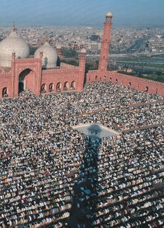 Muslims celebrate the end of Ramadan at Lahore's Badshahi Mosque. -- © National Geographic, October 1997 — in Lahore, Pakistan.