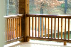 A simple wooden hand rail stained dark