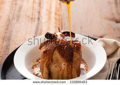 baked apple with a coat of cinnamon dough and an orange Grand Marnier sauce on wooden table as background