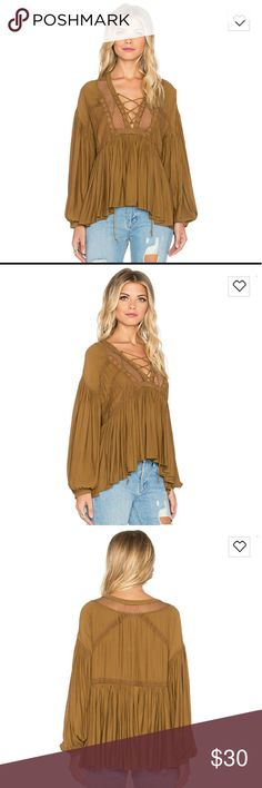 Free people peasant top Worn once size XS, runs a little big. The top looks loose on the model from the back I think it's alot more fitted. Free People Tops Blouses