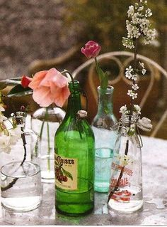 I love the idea of using different wine bottles as vases.