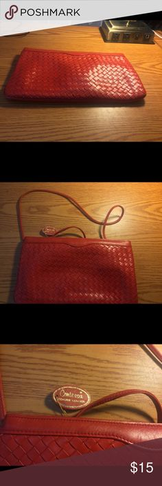 Contessa Red Leather Clutch Great bag! Has shoulder strap. Has a make up smudge inside. Bags Clutches & Wristlets