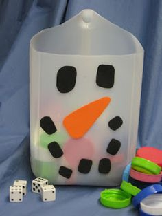 The snowman is a counting game. He is made out of a milk jug and fun foam.  Pretty easy and pretty cute. A child rolls the die and counts out the milk caps.  This is also a good game for learning social skills because each child will have to be patient and wait for their turn.