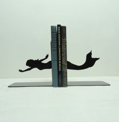 Oh. I am such a big fan.    Mermaid Bookends  FREE USA Shipping by KnobCreekMetalArts on Etsy, $39.99