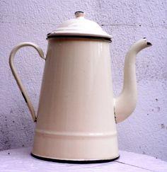 1920's antique cream enamel teapot.. €30.00, via Etsy.