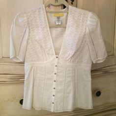 Catherine Malandrino white v-neck blouse ⬜️▫️◽️◻️ Catherine Malandrino gorgeously fitted white v-neck blouse with cut out patterns and white buttons along the front. Worn twice and in PERFECT condition! Feel free to ask any questions. Catherine Malandrino Tops Blouses