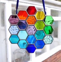 Rainbow Bee Honeycomb Stained Glass Art by TheGlassSeaDesigns inspiration for a pretty suncatcher to make to add colour and light to your room in winter