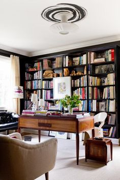 Dedicate an area in your home for a set of big comfy armchairs alongside a wall of bookshelves to create an enormously cozy library corner.