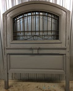 Headboard built from antique French iron transom.