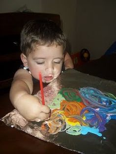 Painting on tinfoil helps to make beautiful swirling colors instead of a toddler's usual brown color combo.