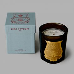 Cire Trudon Solis Rex  Candle: Luxurious candles from the World's oldest candle-maker. The fragrance of the vast wooden floor of the Chateau de Versailles, with vapours of wax, candelabras and the palace. This kingly scent blends green and wooded coniferous trees with incense and citrus.  Founded in Paris in 1643, Cire Trudon is the most notable wax producing factory in France and the oldest candle maker in the world. As the provider of candles for Louis XIV Royal court, Napoleon and some of…