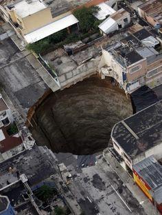Guatemala Sinkhole  is 18 meters (60 feet) wide and 100 meters (300 feet) deep.