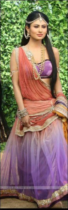 the best portrayal of Princess Sati everrr - Mouni Roy.in Devon Ke Dev Mahadev.modern look and stylish Chaniya Choli and ornaments.Damni mang tika suits her face a lot.Long hair, color combination, what's not to love? Indian Tv Actress, Actress Pics, Indian Actresses, Indian Attire, Indian Wear, Indian Outfits, India Fashion, Asian Fashion, Devon Ke Dev Mahadev