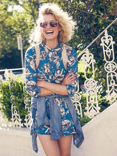 Zanita Whittington of Zanita in a flirty floral dress and lucite sunglasses