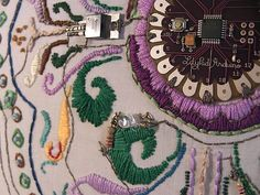 Leah Buechley at the MIT Media Lab made a compilation video of many LilyPad Arduino projects, including our own blinky bike patch and my LilyPad Arduino Em