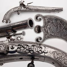Michie Pistol- With its distinctive profile & no wooden stocks, this James Michie-made one is the best example of an all-metal Scottish pistol represented in the museum collection. Finely engraved & with a graceful lyre-shaped buttstock termination, this .56 caliber pistol has a vent pick concealed by the finial ball ornament, which unscrews to reveal the vent pick. The slender ramrod under the muzzle seems hardly strong enough to handle the chore of charging the barrel.