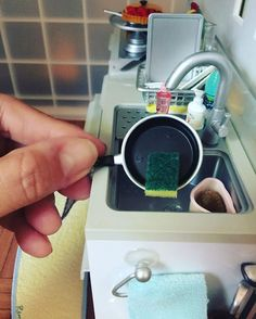 """""""Those dishes arent gonna wash themselves.""""- Mom😆 Teeny tiny dish sponge to the rescue! #miniatures #miniature #dishes #dishwashing #wash…"""