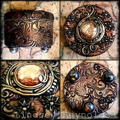 Brown polymer clay covered tin coated with bronze and gold pigment powders. Embellished with Swarovski crystals. Rests on three marbles.