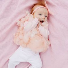 Dress your baby up as a pink, fluffy cone of cotton candy!