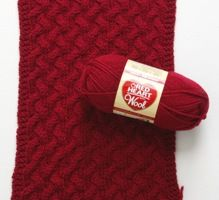 A free knitting pattern for a block-of-the-month afghan featuring With Wool Yarn by Red Heart!