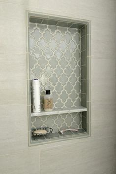Pretty shower niche using Smoke Glass Arabesque tile. https://www.subwaytileoutlet.com/products/Smoke-Arabesque-Glass-Tile.html.VWj1j_lViko