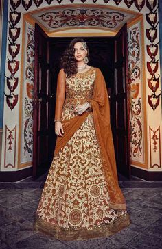 Buy Online Designer Suit or shuits Mustard Color, Net and Santoon material, Chiffon dupattas, Ceremonial Wear, Partywear, Kitty Partywear for women, Anarkali Suits, Anarkali suit, shuits for women.. We have large range of Anarkali suits in our website with the best pricing and unique designs shipping to (UK, USA, India, Germany, UAE, Canada, Singapore, Australia, Mauritius, New Zealand) world wide.