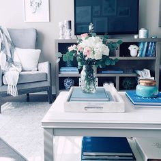 grey, white, blue living room in apartment decor @homegoods tv stand and chair